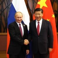 Путін кидає виклик Заходу в Україні, а Сі Цзінпінь у Тайвані